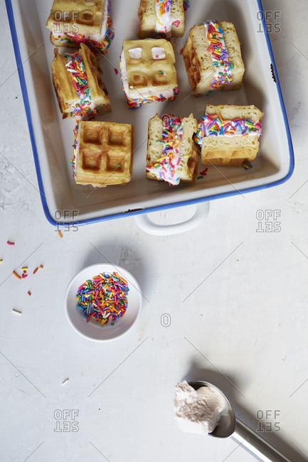 Waffle ice cream sandwiches served with sprinkles