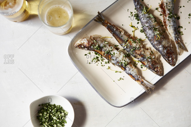 Fresh cooked sardines served with a garnish