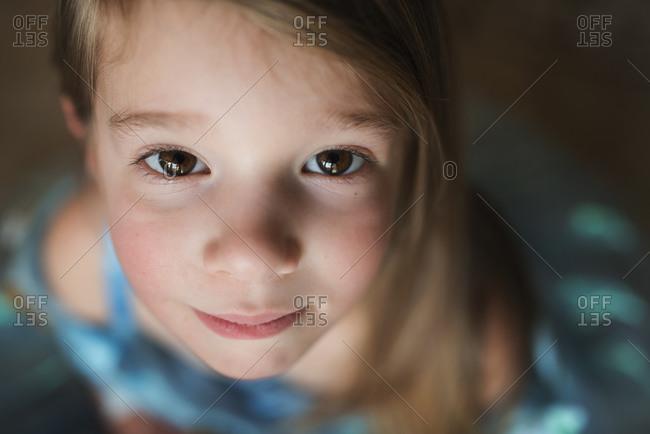 Portrait of a girl in a blue princess dress