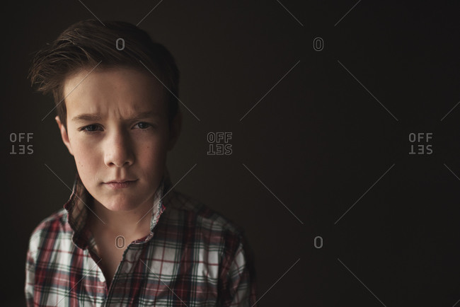 Portrait of a boy with an inquisitive expression