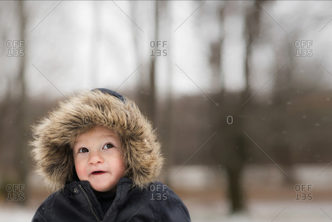 Portrait of baby outside wearing furry jacket