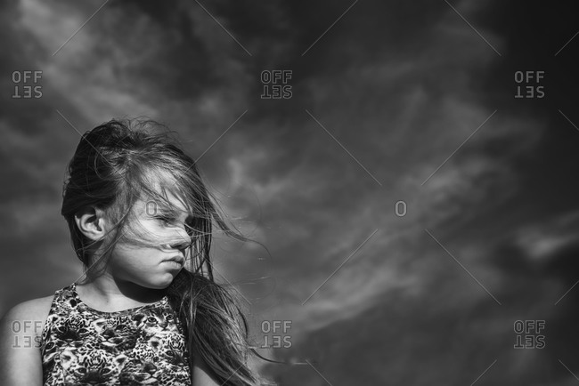 Portrait of a girl outside on a windy day