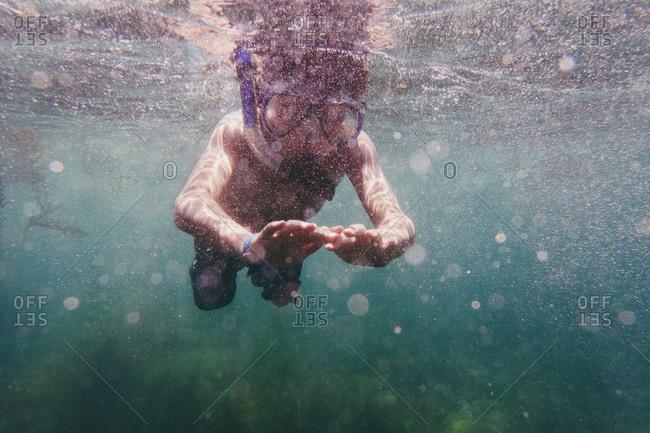 Kid snorkeling in ocean