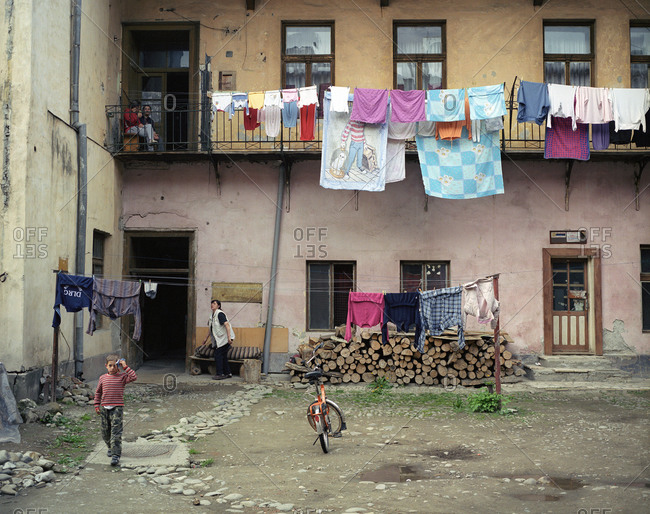 Romania - February 24, 2012: Clothes hanging from the balcony of an aging apartment building in Transylvania, Romania