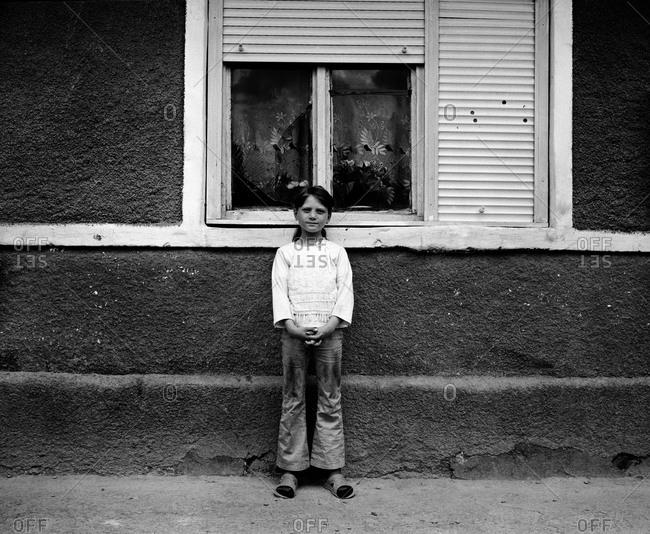 Romania - November 14, 2008: Portrait of a girl in the small rural town of Rupea, Transylvania, Romania