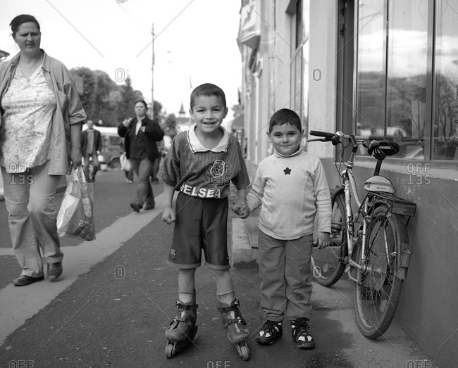 Romania - December 9, 2011: Portrait of two young boys on the street in Transylvania, Romania