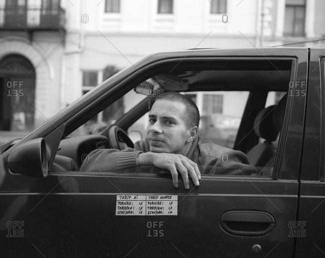 Romania - December 9, 2011: Portrait of a taxi driver in Transylvania, Romania
