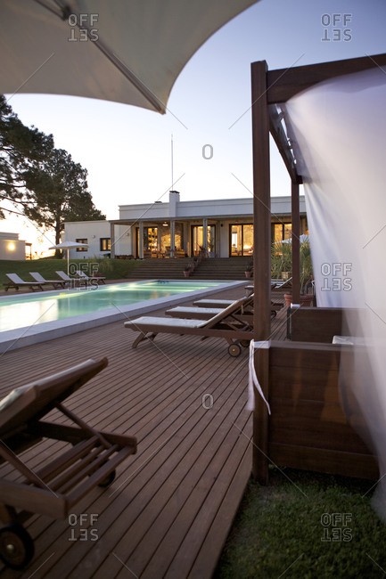 Carmelo, Uruguay - June 21, 2013: Carmelo, Uruguay - June 21, 2013: Swimming pool in the evening at the Hotel Casa Chic, Carmelo, Uruguay