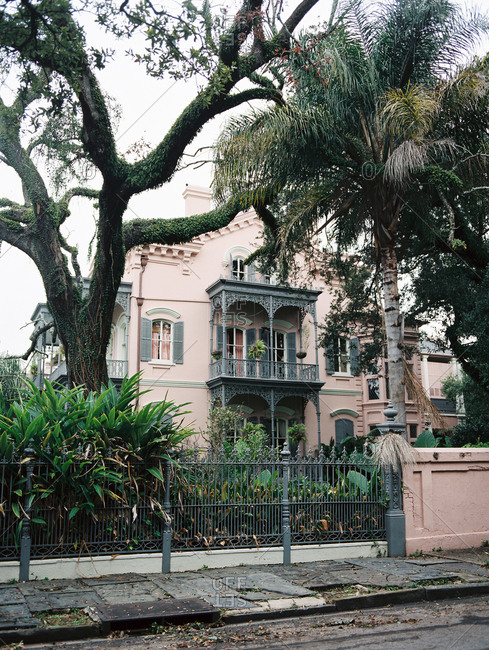 Street view of a historic mansion in New Orleans