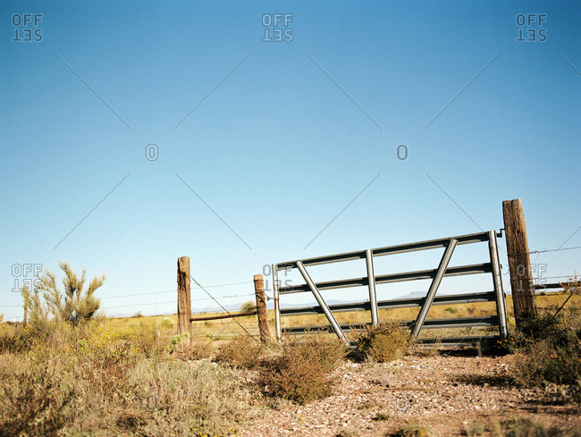 Rural gate in barbed wire fence