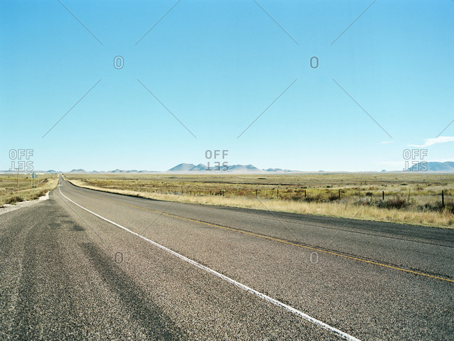 Deserted highway with mountains in distance