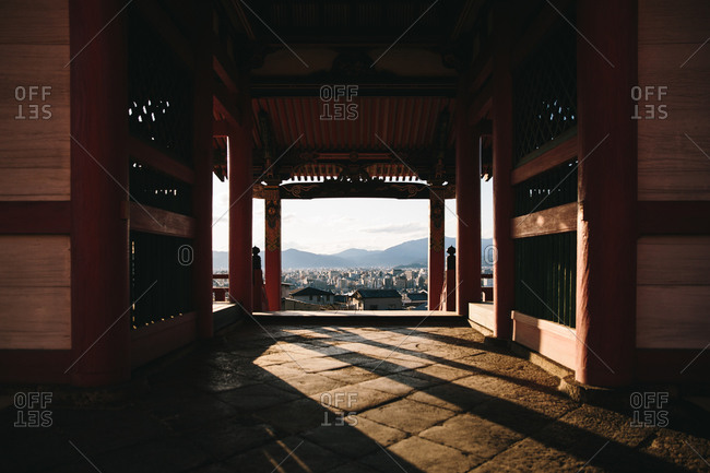View of a city skyline from the interior of a Buddhist temple in Japan