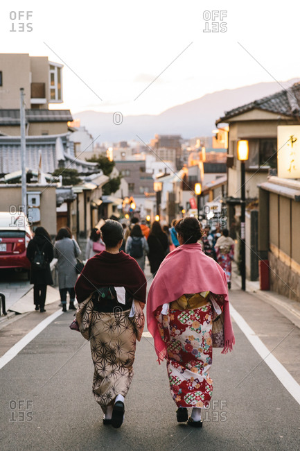 Two Japanese women wearing kimono's walking down the street