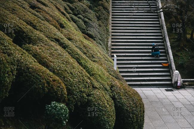 Man repairing a public staircase in park