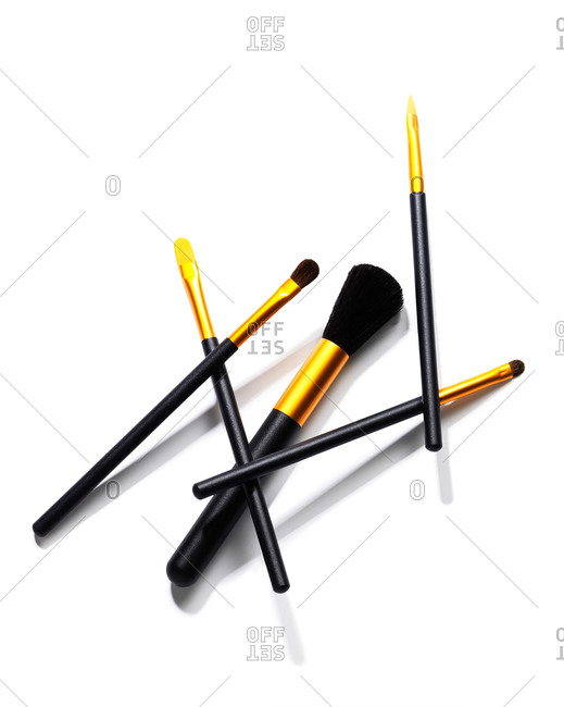 Makeup brushes on a white seamless background