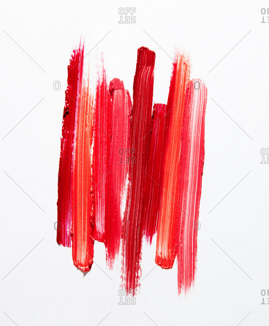 Lipstick smear on a white seamless background stock photo - OFFSET