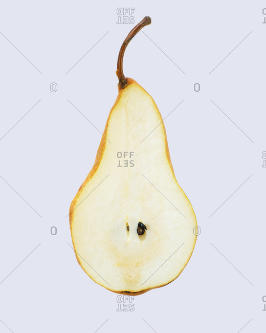 Cross section of a pear on a white seamless background
