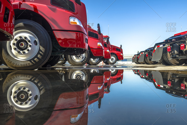 Rows of red tractor trailers parked side-by-side at the Port of Los Angeles
