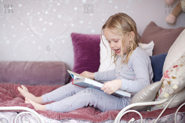 Girl reading a storybook