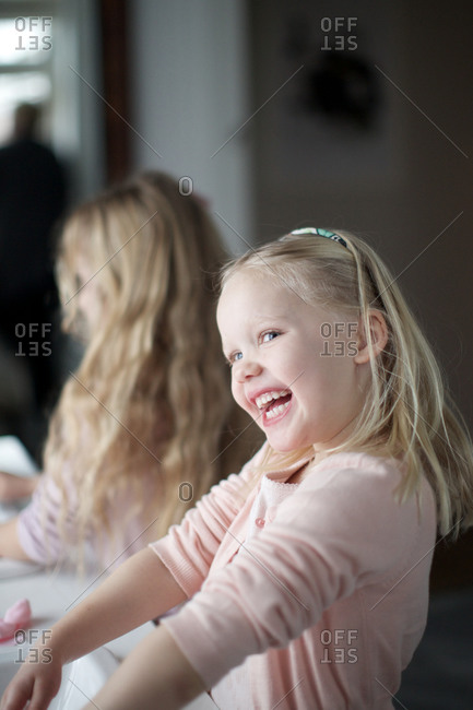 Girl having fun at the bathroom sink