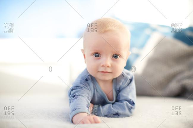 Portrait of a cute little baby boy with blue eyes