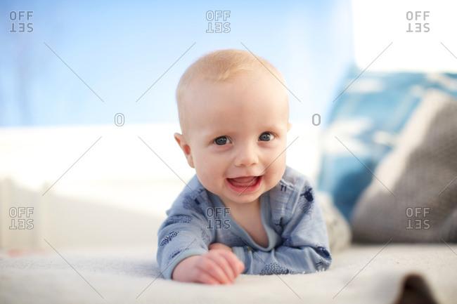 Portrait of little baby boy lying in bed