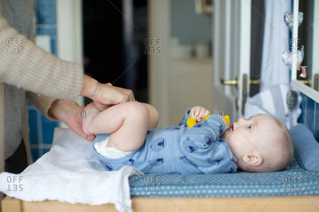 Mother with baby holding toy