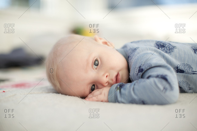 Adorable baby boy lying in bed