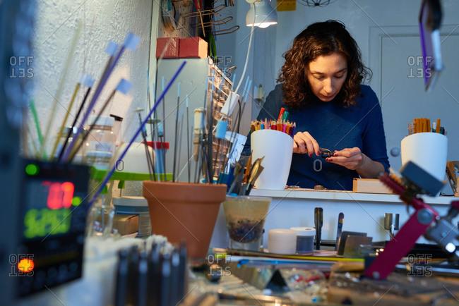 Woman in jewelry making workshop