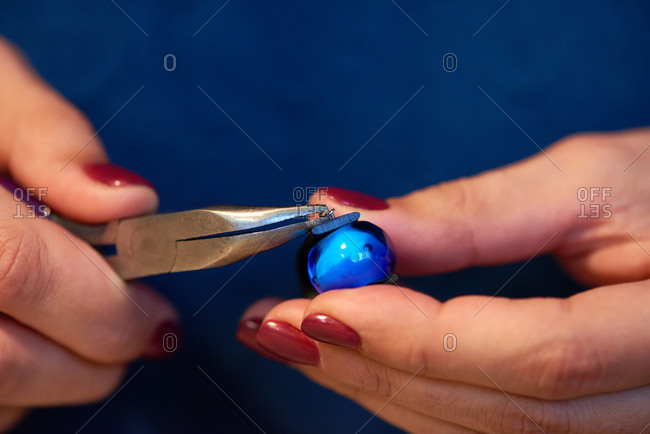 Woman working with jewelry bead
