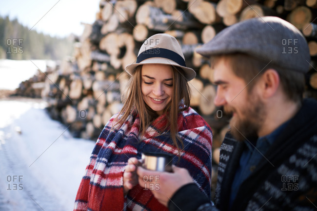 Couple sharing drink in winter