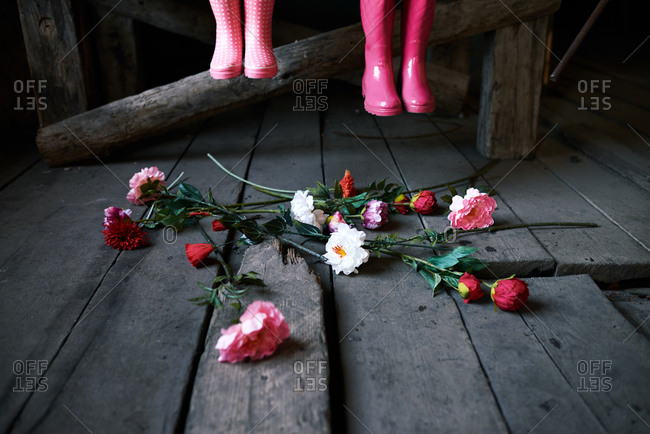 Boots over scattered flowers