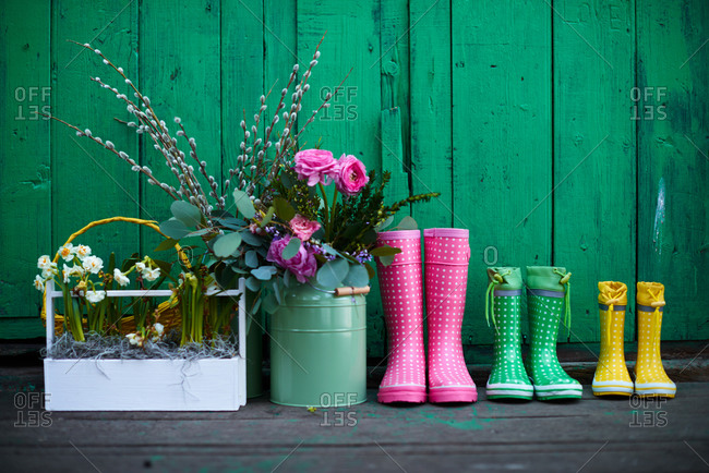 Flower and rain boots on porch