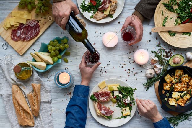 Pouring wine among various foods
