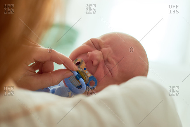 Giving crying baby a pacifier