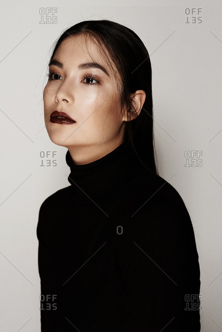 Portrait of woman in a black turtleneck