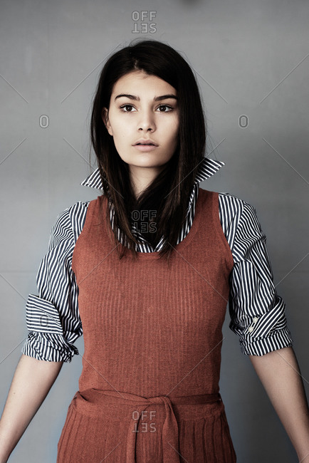 London, United Kingdom - May 21, 2015: Portrait of a woman in a sweater dress and striped shirt