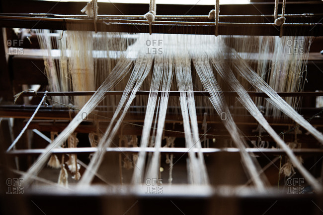Threads on a loom in natural light