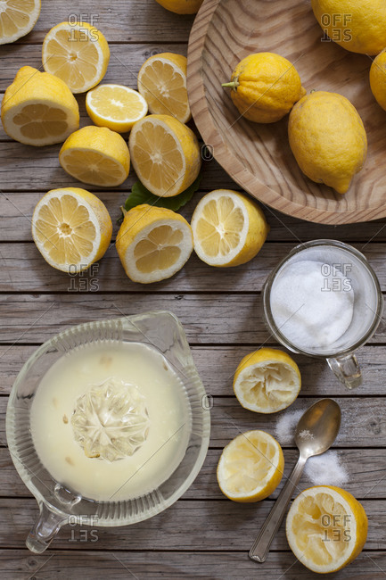 Overhead view of lemons, juicer, and sugar