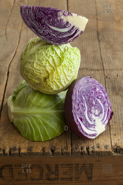 Green and red cabbage on wooden box