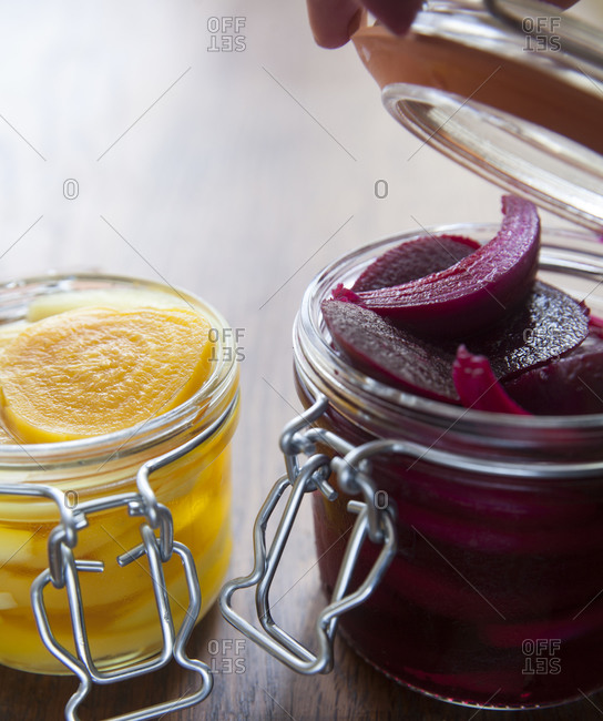 Jars of red and yellow pickled beets