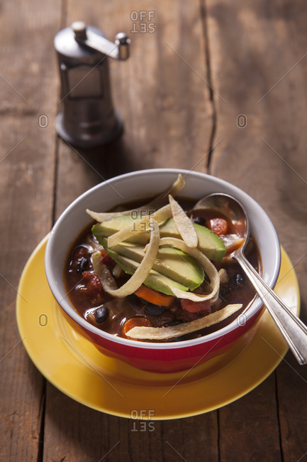 Mexican soup with cabbage, black beans and tomatoes