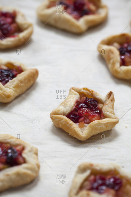 Fruit pastries on baking sheet