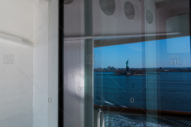 View of the Statue of Liberty from a boat window