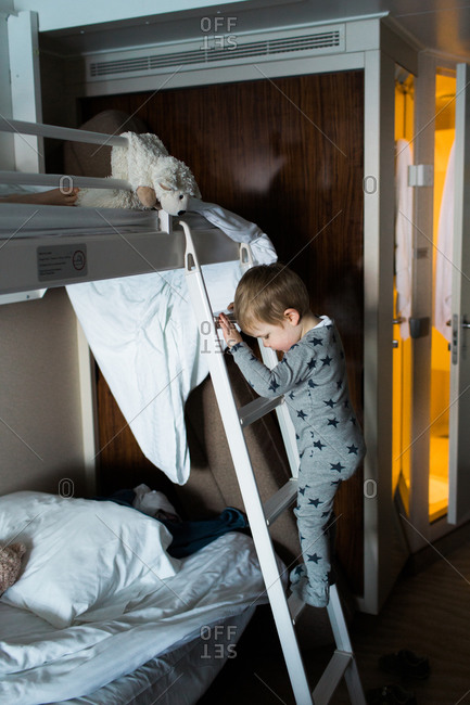 Boy Climbing Up A Ladder To A Bunk Bed On A Cruise Ship Stock Photo