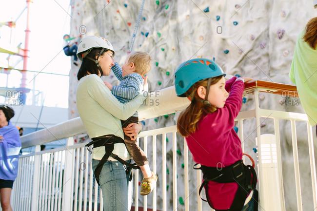 Family preparing to climb a rock wall