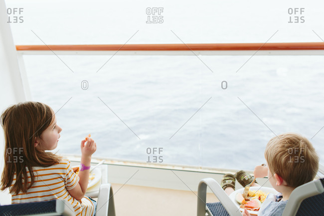 Children eating breakfast on a cruise ship