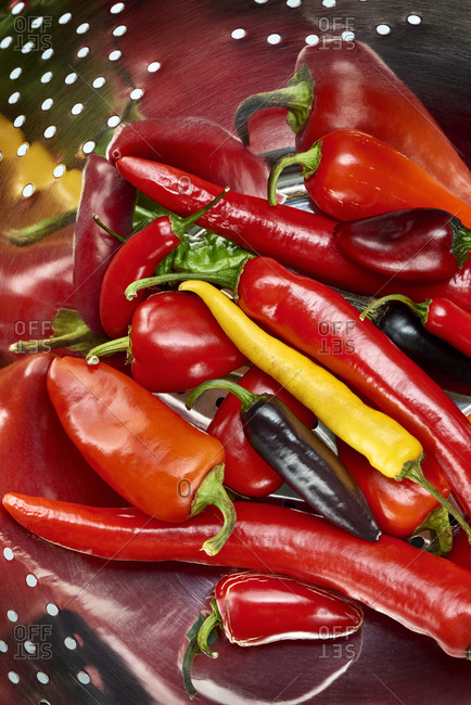 Colorful fresh peppers in a colander