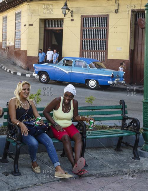 Santiago de Cuba, Cuba - February 2, 2016: Women at Plaza de Dolores, Santiago de Cuba, Cuba