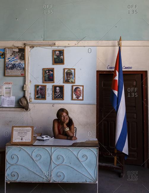 Santiago de Cuba, Cuba - February 3, 2016: Receptionist at a governmental carpentry, Santiago de Cuba, Cuba